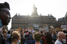 People take part in a Black Lives Matter protest in front of the Royal Palace on Dam Square in Amsterdam, Netherlands, Monday,…