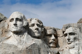 FILE - This March 22, 2019, file photo shows Mount Rushmore in Keystone, S.D. Organizers have scrapped plans to mandate social…