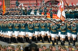 Russian soldiers march toward Red Square during the Victory Day military parade marking the 75th anniversary of the Nazi defeat…