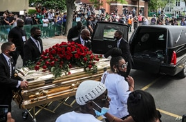 CORRECTS TO MEMORIAL SERVICE, NOT FUNERAL - George Floyd's casket carried to a hearse after a memorial service for Floyd at…