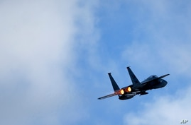 U.S. F15C Eagle jet fighter flies over Vilnius during the Lithuanian - NATO air force exercise at the Siauliai airbase some 230…