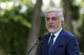 Abdullah Abdullah, Chairman of the High Council for National Reconciliation, speaks during a press conference in Kabul,…