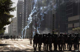 Police clash with anti-government demonstrators in Sao Paulo, Brazil, Sunday, May 31, 2020. Police used tear gas to disperse…
