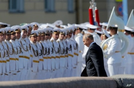 Russian President Vladimir Putin arrives to attend the military parade during the Navy Day celebration in St.Petersburg, Russia…