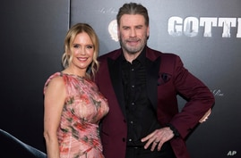 "FILE - In this June 14, 2018, file photo, Kelly Preston and John Travolta attend the premiere of ""Gotti"" at the SVA Theatre in…"