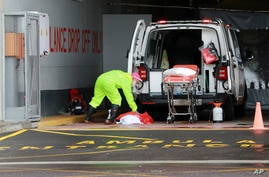 A paramedic sanitises an ambulance at the Christiaan Barnard Memorial Hospital in Cape Town, South Africa, Friday July 10, 2020…