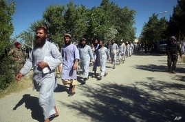 Prisoners are released from Bagram Prison in Parwan province, Afghanistan, Tuesday, May 26, 2020. The Afghan government freed…