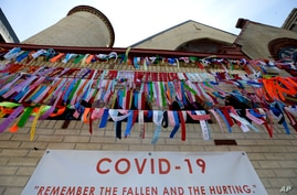 Ribbons hang in remembrance of victims of the coronavirus pandemic outside the Grant African Methodist Episcopal Church,…
