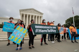 In this June 18, 2020, photo, Deferred Action for Childhood Arrivals (DACA) students celebrate in front of the Supreme Court…