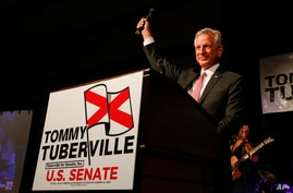 Former Auburn football coach Tommy Tuberville speaks to supporters after he defeated Jeff Sessions in Republican primary for U…