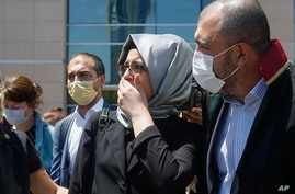 Hatice Cengiz, the fiancee of slain Saudi journalist Jamal Kashoggi, leaves a court in Istanbul, Friday, July 3, 2020, where…