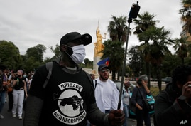 "Members of ""Brigade Anti Negrophobia"" and anti-racism groups attend a ""de-colonial tour"" next to the French capital's Museum of…"
