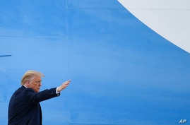 President Donald Trump waves from the top of the steps of Air Force One at Andrews Air Force Base in Md., Friday, July 10, 2020…
