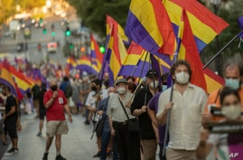 Demonstrators holding a Republican flag march during a protest against Spanish Monarchy in Madrid, Spain, Saturday, July 25,…