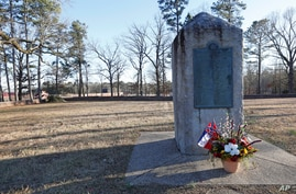 File-This March 5, 2019, file photo shows a memorial marker standing in the University of Mississippi campus cemetery that has…