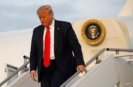 President Donald Trump steps off Air Force One at Morristown Municipal Airport in Morristown, N.J., Friday, July 24, 2020…