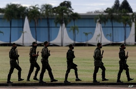 Soldiers patrol outside the president's official residence, Alvorada Palace, in Brasilia, Brazil, Wednesday, July 8, 2020…