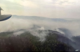 This image taken from video provided by Russian Emergency Ministry, shows a view of a forest fire from a Russian Emergency…