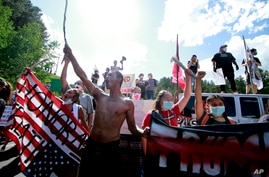 Native American protesters form a roadblock on the road leading to Mount Rushmore ahead of President Donald Trump's visit to…