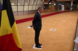 Czech Republic's Prime Minister Andrej Babis stands on a physical distancing marker as he makes a statement on arrival for an…