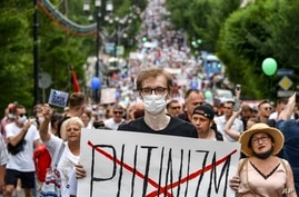 "A man holds poster reading ""Putinizm "" during an unsanctioned protest in support of Sergei Furgal, the governor of the…"