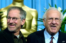 """FILE - Steven Spielberg, nominated for best director for his work on """"Munich,"""" left, arrives with his father Arnold for the…"""