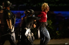 Portland police make arrests on the scene of the nightly protests at a Portland police precinct on Sunday, Aug. 30, 2020 in…