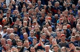 Workers react as they gather during a rally at the Minsk Automobile Plant in Minsk, Belarus, Friday, Aug. 14, 2020. Workers at…