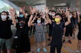 "Protesters gesture with five fingers, signifying the ""Five demands - not one less"" outside a court during a protest in Hong…"