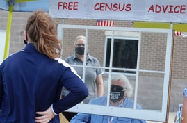 Amid concerns of the spread of COVID-19, census worker Ken Leonard wears a mask as he mans a U.S. Census walk-up counting site…