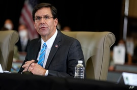 FILE - In this July 10, 2020, file photo Defense Secretary Mark Esper speaks during a briefing on counternarcotics operations…