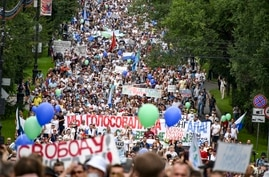 People hold various posters supporting Khabarovsk region's governor Sergei Furgal, during an unsanctioned protest in support of…
