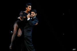 Valentin Delgado and Diana Franco, from Colombia, compete during the finals of the Stage category of the Tango Dance World…