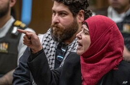 Manal Dokhan gestures as she gives her victim impact statement during the sentencing hearing for Australian Brenton Harrison…