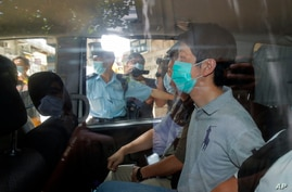 Pro-democracy legislator Ted Hui is arrested by police officers in Hong Kong, Wednesday, Aug. 26, 2020. Hong Kong police…