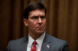 FILE - In this Oct. 7, 2019, file photo, Defense Secretary Mark Esper participates in a briefing with President Donald Trump…