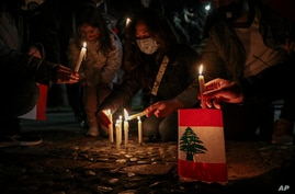 Lebanese residents in Chile hold a vigil for the victims of the deadly explosion which devastated the port and large parts of…