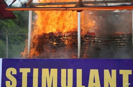 Flames and smoke rise from burning illegal drugs during a destruction ceremony to mark International Day against Drug Abuse and…