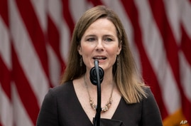 Judge Amy Coney Barrett speaks after President Donald Trump announced her as his nominee to the Supreme Court, in the Rose…