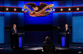 President Donald Trump, left, Democratic presidential candidate former Vice President Joe Biden, right, speaking during the…
