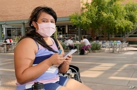 Arizona State University political science major Betzabel Ayala poses for a photo on campus Tuesday, Sept. 8, 2020, in Tempe,…