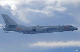 In this photo released by the Taiwan Ministry of National Defense, a Chinese People's Liberation Army H-6 bomber fitted with…