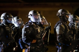 Portland police take control of the streets after making arrests on the scene of the nightly protests at a Portland police…