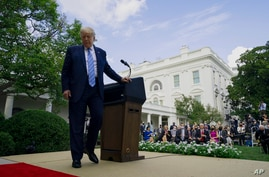 President Donald Trump leaves after an event about coronavirus testing strategy, in the Rose Garden of the White House, Monday,…