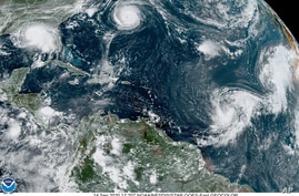 This satellite image provided by the NOAA shows five tropical cyclones churning in the Atlantic basin at 5:20 p.m. GMT on…