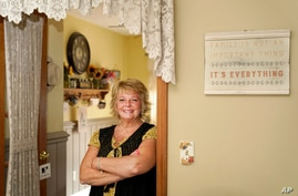 Kay Orzechowicz poses Wednesday, Sept. 2, 2020, for a portrait at her Griffith, Ind., home. After 35 years of teaching,…