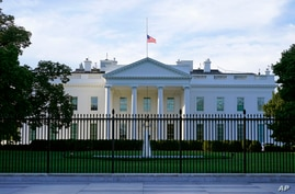 An American flag flies at half-staff over the White House in Washington, Saturday, Sept. 19, 2020.  Federal officials have…