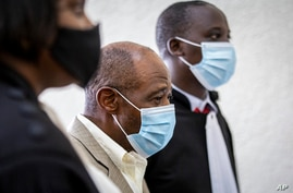 """Paul Rusesabagina, center, who inspired the film """"Hotel Rwanda"""" for saving people from genocide, appears at the Kicukiro…"""