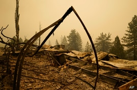 Property is left in ruins after the Creek Fire passed through Tuesday, Sept. 8, 2020, in Tollhouse, Calif. (AP Photo/Marcio…