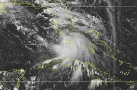 This Saturday, Sept. 12, 2020 image provided by NOAA shows the formation of Tropical Storm Sally. The storm is expected to…